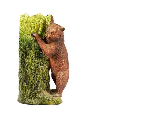 A glazed ceramic bear stick stand