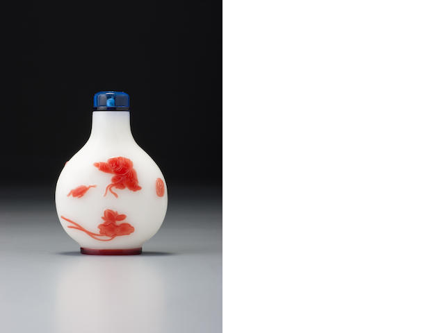 A ruby-red glass overlay 'Liu Hai' snuff bottle Yangzhou, 1830-1890