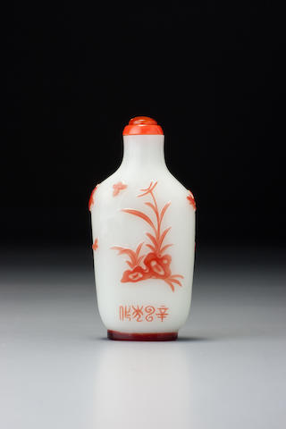 An inscribed ruby-red glass overlay 'chicken' snuff bottle Yangzhou, dated 1881