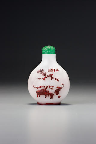 An inscribed cinnabar-red glass overlay 'auspicious objects' snuff bottle Yangzhou, 1830-1890