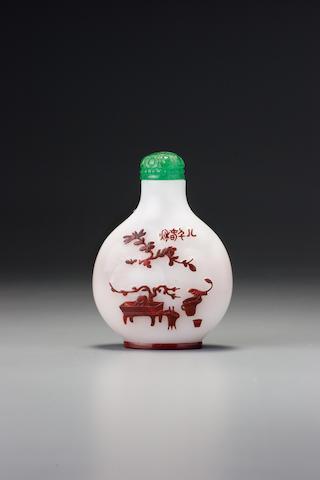 An inscribed cinnabar-red glass overlay 'auspicious objects' snuff bottle Yangzhou, 1830-1890