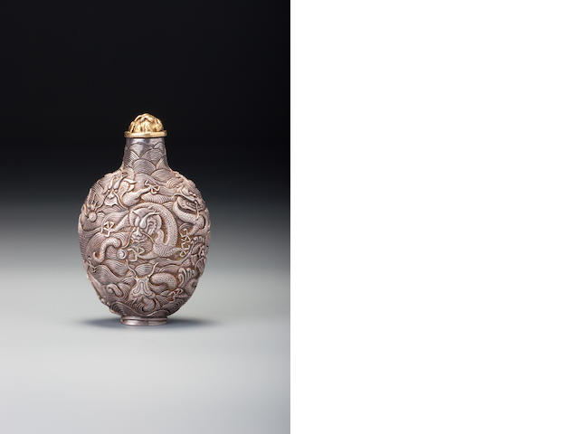 A silver 'nine dragons' snuff bottle Yuanxin, 1760–1850