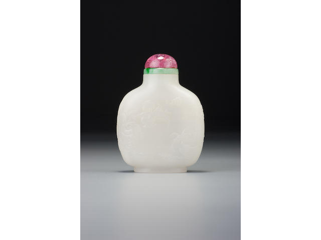 A white nephrite 'auspicious plants' snuff bottle Attributable to Suzhou, 1720–1780