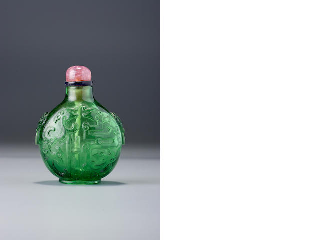 A transparent green glass 'kui dragons' snuff bottle Imperial glassworks, Beijing, 1720-1770
