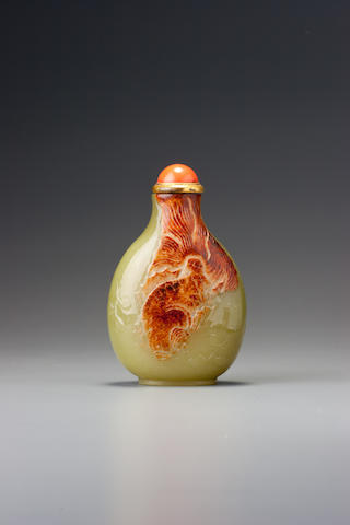 A pale green and russet nephrite pebble-material 'fish' snuff bottle 1770–1880