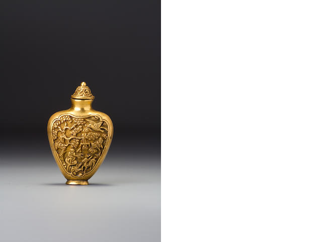 A gilded bronze 'auspicious objects' snuff bottle   Probably Imperial, 1750–1820