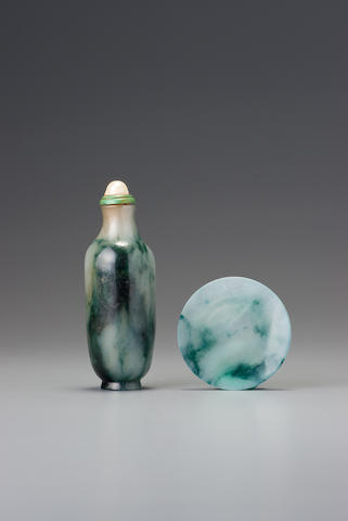 A jadeite snuff bottle with matching dish Probably Imperial, attributable to the palace workshops, Beijing, 1770–1830