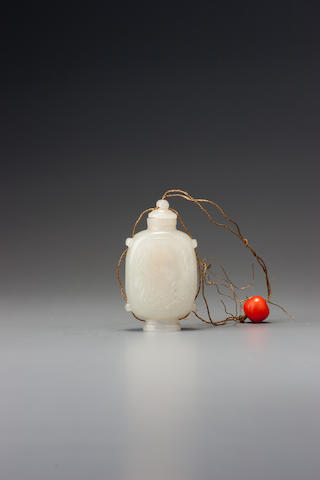 An inscribed white nephrite snuff bottle Probably Imperial, attributable to the palace workshops, Beijing 1720–1780