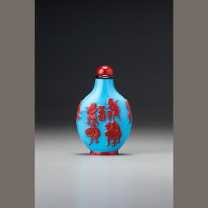 An inscribed cinnabar-red and turquoise-blue glass overlay 'Zhong Kui' snuff bottle Yangzhou, 1870-1890