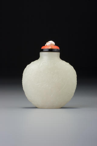 A white nephrite 'Indian lotus' snuff bottle Probably Imperial, attributable to Xifanzuo (Tibetan workshop), Beijing, 1758–1820