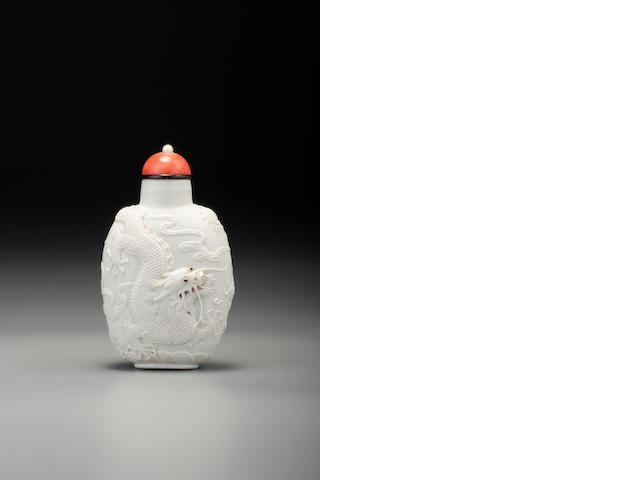 A carved white porcelain 'dragons' snuff bottle Li Yucheng, probably Imperial, Jingdezhen, 1820–1870