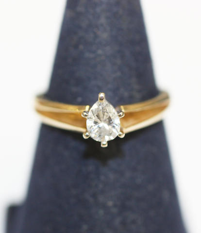 A pear shaped single stone diamond ring the pear-cut diamond claw set, yellow gold shank stamped '14k', diamond approximately 0.48ct, ring size M.