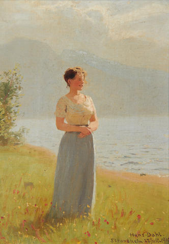 Hans Dahl (Norwegian, 1849-1937) Girl beside a fjord