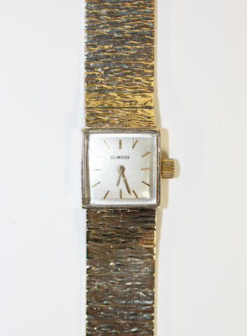 Longines: A 9ct gold lady's wristwatch,