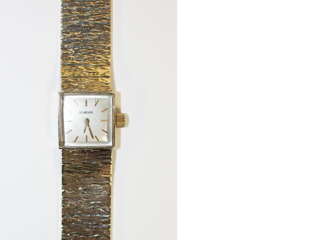Longines: A 9ct gold lady's wristwatch,