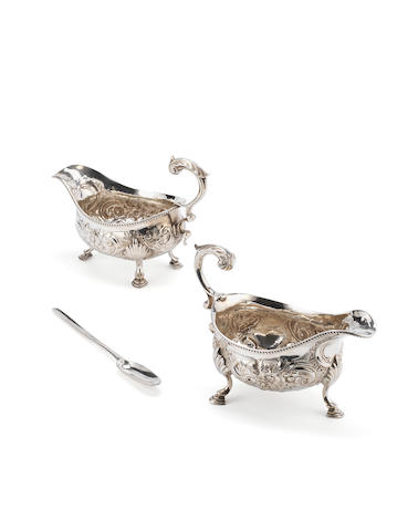 A pair of George III silver sauce boats, by Charles Hougham. London 1777,  (3)