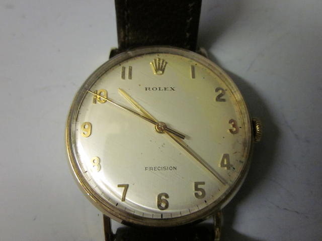 Rolex: A gents 9 carat gold strap watch,