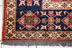 A Caucasion design Afghan carpet, 310 x 197cm