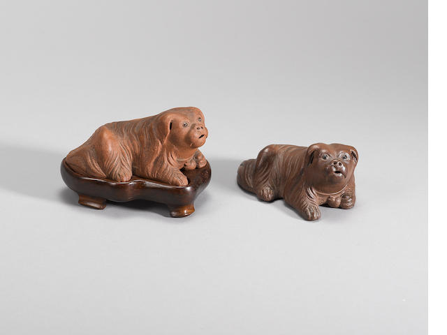 A matched pair of Yixing stoneware dogs Qing dynasty