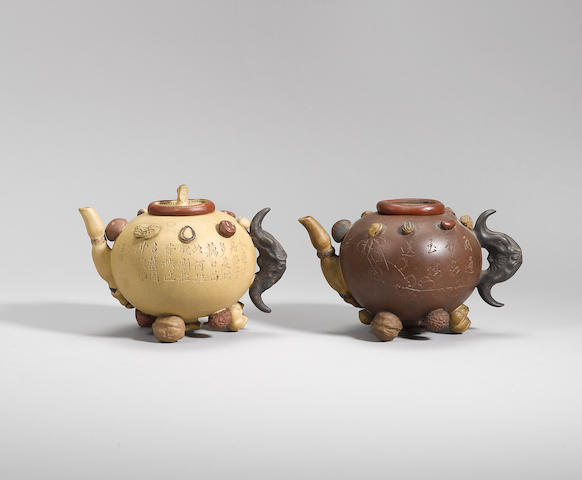 Two Yixing stoneware 'hundred-fruit' teapots and covers Qing dynasty