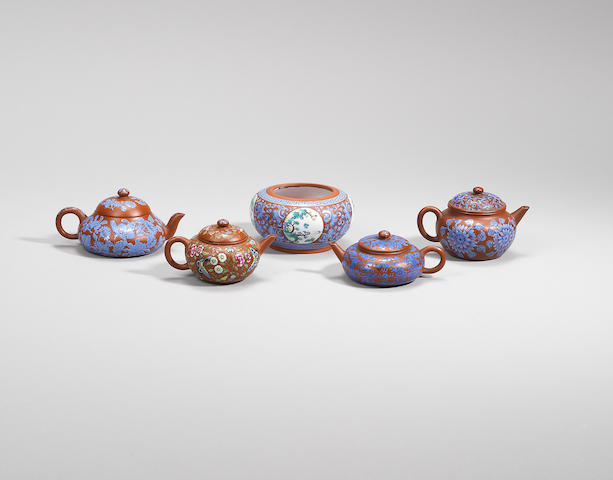 A group of four enamelled Yixing stoneware teapots and covers and a waterpot Qing dynasty