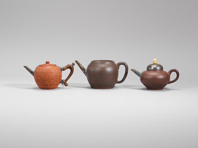 A group of three silver-mounted Yixing stoneware teapots and covers Late Ming/early Qing dynasty