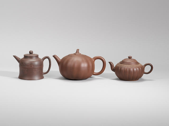 Three Yixing stoneware teapots and covers Mid Qing dynasty