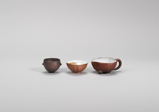 An Yixing stoneware incised teacup and two other cups Qing dynasty