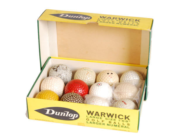 12 round dimple patterned rubber-cored golf balls