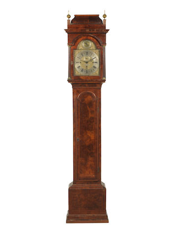 An 18th Century walnut veneered langcase clock by Thomas Glover.