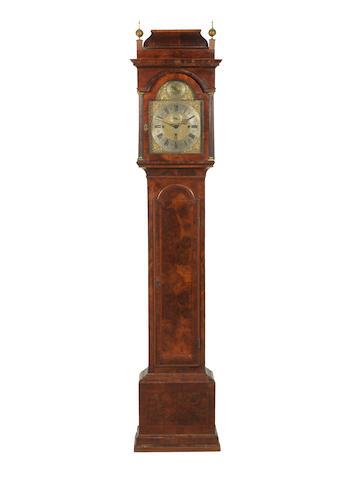 An 18th Century walnut veneered langcase clock by Thomas Glover.
