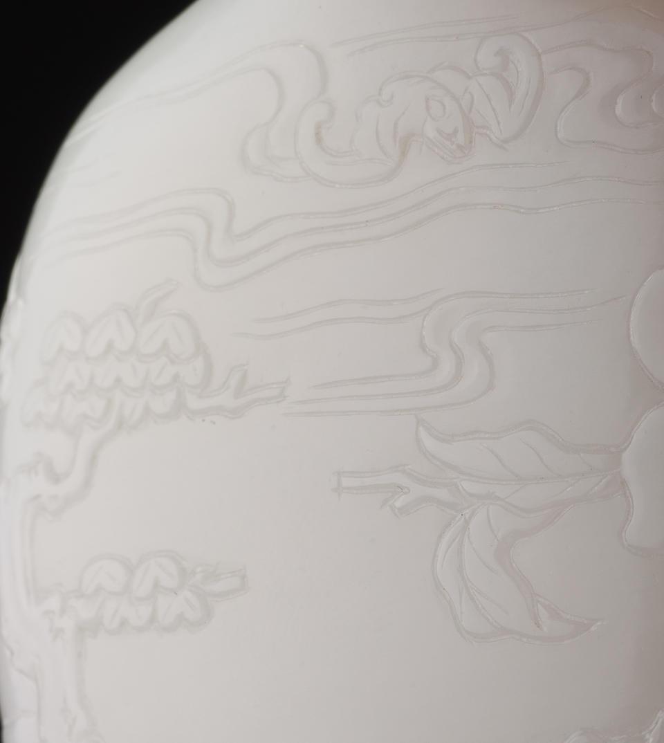 A white nephrite 'auspicious plants' snuff bottle Attributable to Suzhou, 1720–1780