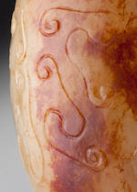 An inscribed pebble-material nephrite 'taotie' snuff bottle     Yitang seal mark, 1780–1833