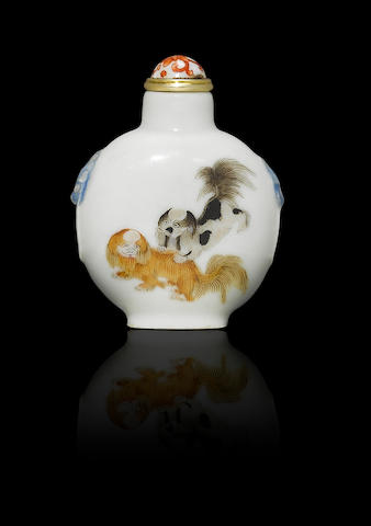 An enamelled porcelain 'dogs and doves' snuff bottle Daoguang four-character iron-red seal mark and of the period