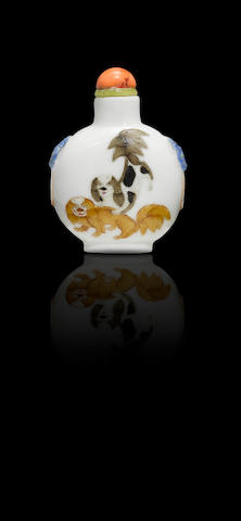 A 'famille rose' enamel on porcelain 'Pekinese dogs and doves' snuff bottle Daoguang iron-red four-character seal mark and of the period