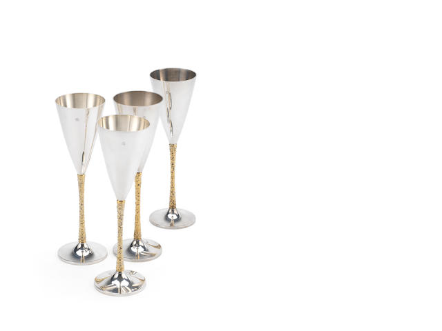 STUART DEVLIN: A set of four silver and silver-gilt champagne flutes London 1977  (4)