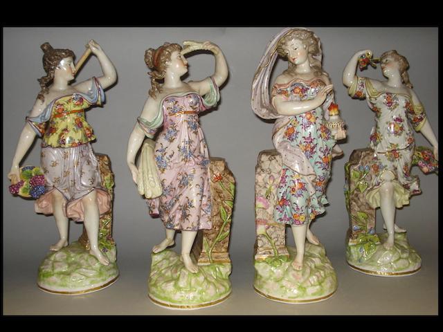 A set of four 19th century Dresden porcelain figures