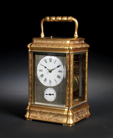 A fine and rare late 19th century French striking and repeating engraved gilt brass carriage clock Charles Frodsham, Clockmaker to the Queen, 84 Strand, London, number 1010.  The movement further bearing the stamp of Richard and Company.