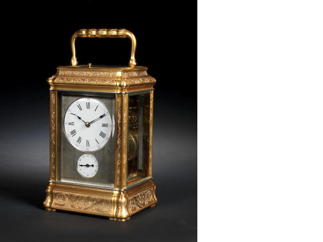 A fine and rare late 19th century French striking and repeating engraved gilt brass carriage clock Charles Frodsham, Clockmaker to the Queen, 84 Strand, London, number 1010.  The movement further bearing the stampof Richard and Company.