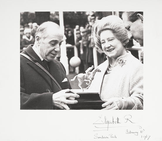 A Photograph of the Queen Mother presenting a trophy at Sandown Park