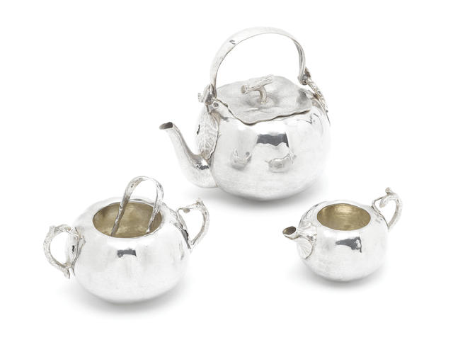 LONDON:  Victorian three piece silver tea service, by J W Benson, 1892, and matching sugar tongs (4)