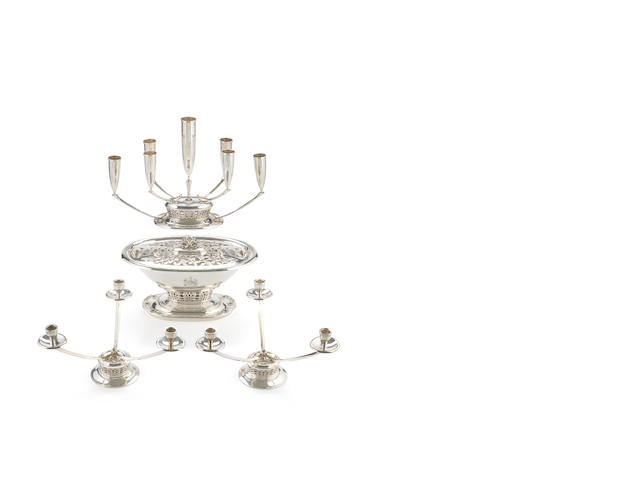 An unusual  silver centrepiece and candelabrum together with a pair of candelabra ensuite by Boodle and Dunthorne, of Liverpool, London 1963 and 1964  (4)