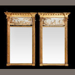 A pair of gilt framed inverted breakfront pier glassesWith verre eglomise panels flanked by corinthian pillasters, 72cm wide (2)