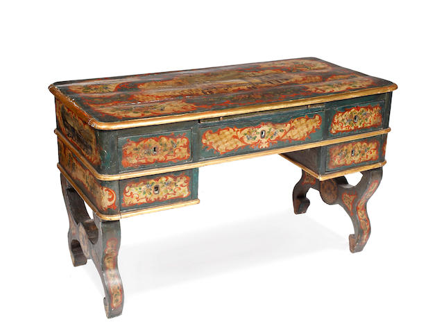 A 19th Century Venetian painted bureau platThe top with a scene of St Marks square within a rococo border and floral panels, with a kneehole arrangment of five drawers on scrolled supports, 122 x 64cm
