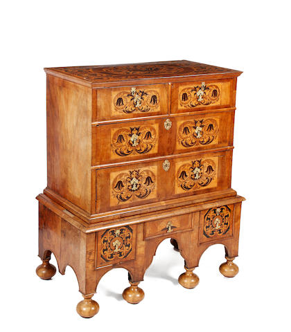An early 18th Century walnut and foliate marquetry chest on stand