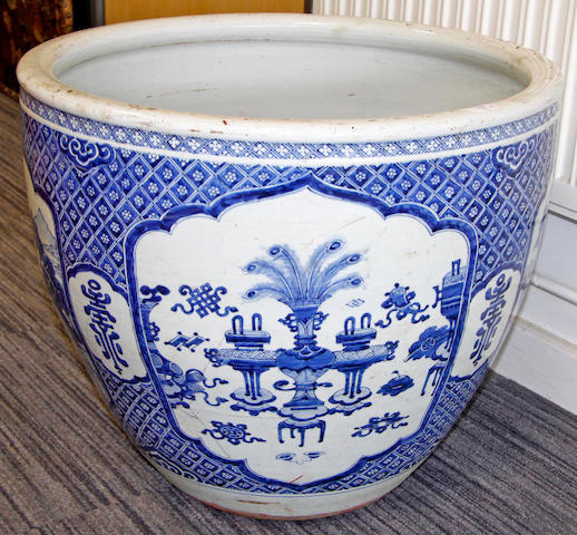 A Chinese blue and white jardiniere of large size and another smaller famille rose jardiniere.