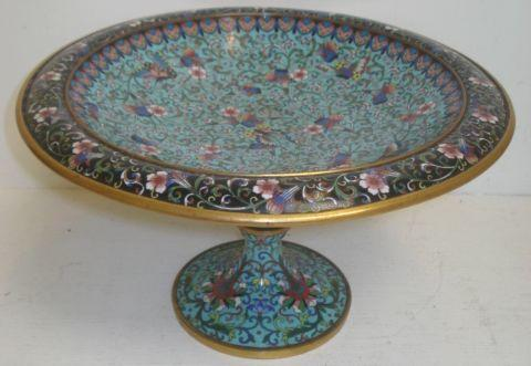 A cloisonne enamel fruit comport, late 19th Century, of European shape, decorated with butterflies amongst flowering scrolling branches on a pale blue ground, 30cm.