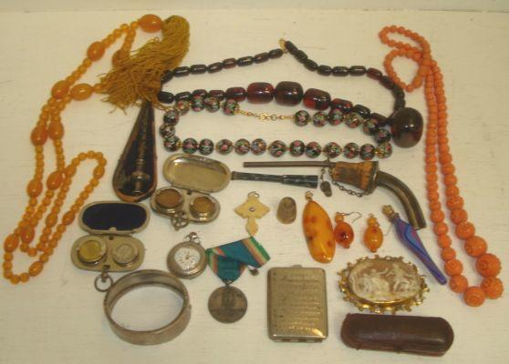 A cased 9ct gold mounted amber cigarette holder, and miscellaneous items to include sovereign and half sovereign cases, Victorian hinged engraved bangle, champagne top, late 19th Century silver cased fob watch, carved oval shell cameo brooch, amber beads and other items.