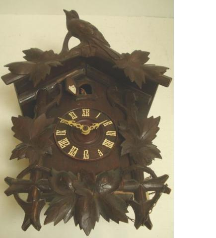 A Black Forest carved wooden cuckoo clock, 48cm.