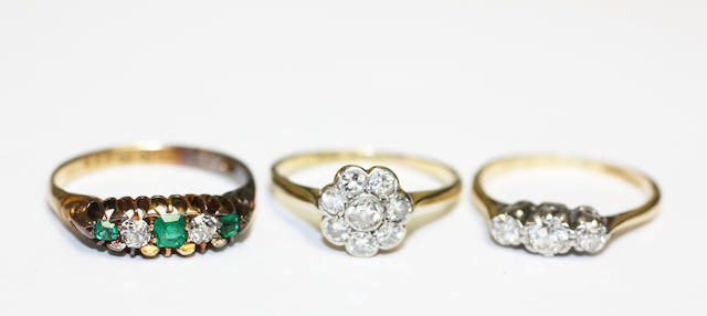 Two diamond rings and an emerald and diamond five stone ring
